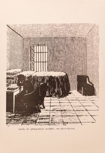 A patient writing in his cell.
