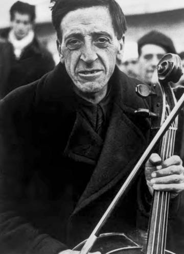 Portrait of Robert Capa of a musician from the Philharmonic of Barcelona Campo de Bram March 1939.