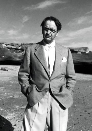 The writer Raymond Chandler, on a beach.