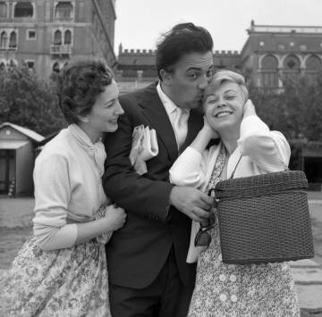 Fellini with actress Valentina Cortese and his wife Giulietta Masina in Venice, in 1955.