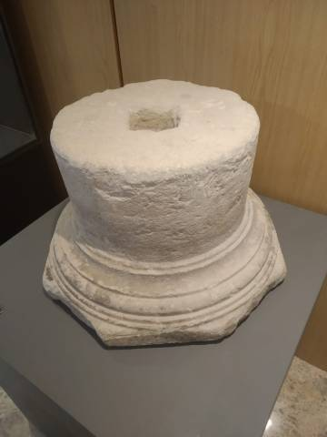 Byzantine column base found at the El Monastil site.