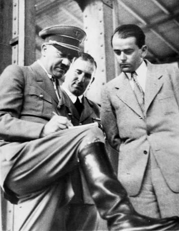 Adolf Hitler touches some designs for Albert Speer (right).
