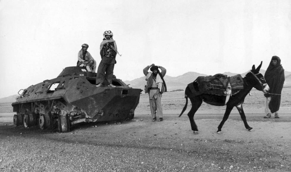 Afghan Mujahideen before a Soviet taque in 1979.