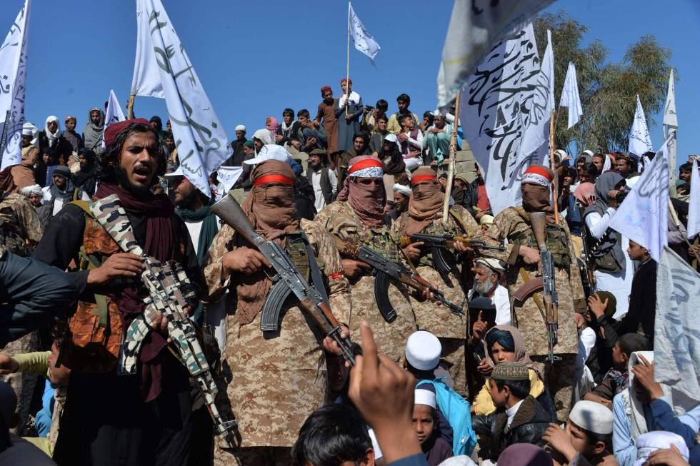 Taliban celebrate the ceasefire in Laghman province.