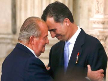 Don Juan Carlos hugs his son on the day of his abdication ceremony, June 18, 2014.