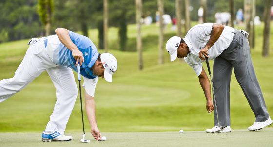 Sergio García y Tiger Woods en The Players.