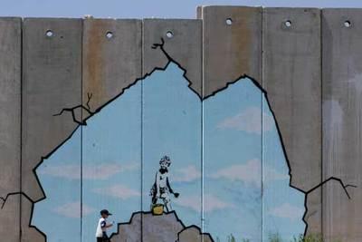 Banksy quiere convertir el muro de Cisjordania en la mayor galera