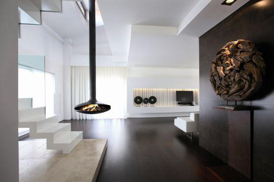 Chimeneas que calientan y decoran vivienda el pa s for Estufa hogar moderna