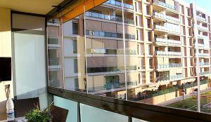 vista de la colocacin de las cortinas de cristal de la empresa vitroglass - Acristalar Terraza