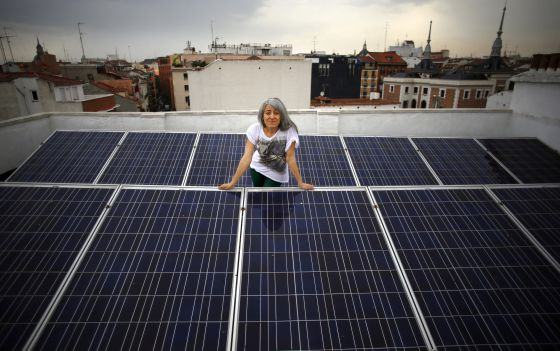 Montse Romanillos on the solar panel-covered roof of her building in Madrid.