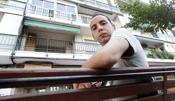 Ernesto Soriano in front of the property in which he lives with his grandmother.