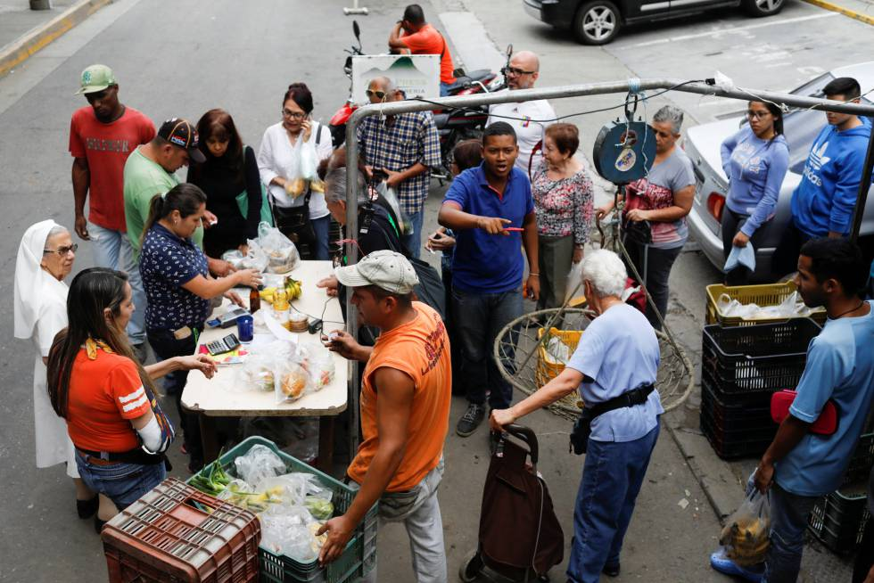 Malnutrition In Venezuela Venezuelans Going To Bed Hungry As Food  A Fruit And Vegetable Market In Caracas Academic Writers also Essay About Learning English Language  A Modest Proposal Essay