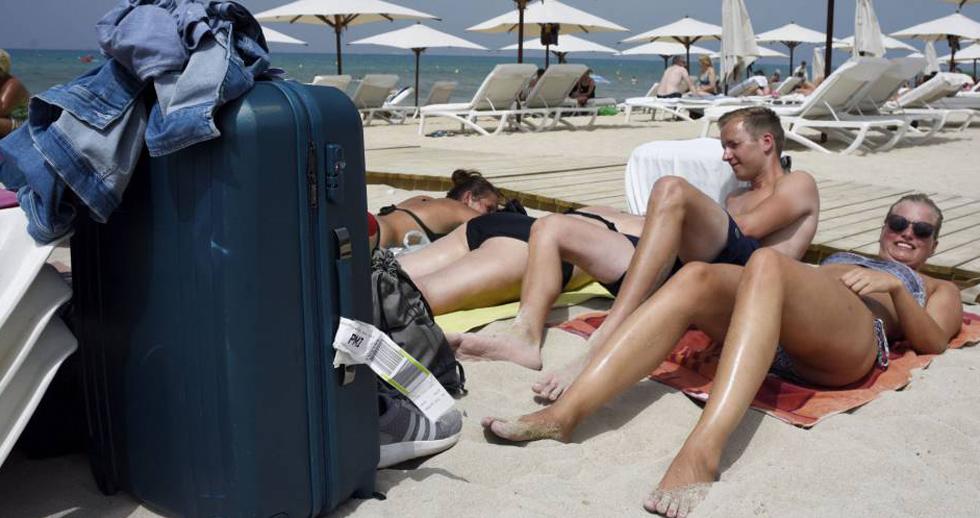 Turistas en la playa de Palma.