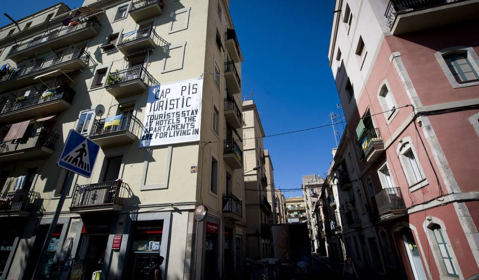 A Sign In Barcelona Protesting Tourist Apartments And Telling Tourists To Stay Hotels