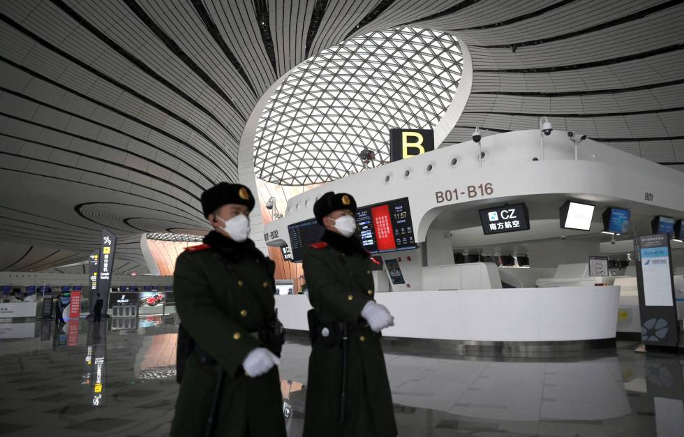 Police officers patrol at the Beijing airport.