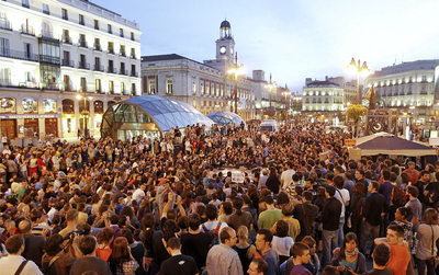 Hundreds of mostly young protestors assembled in Madrid's Puerta del Sol on Monday.