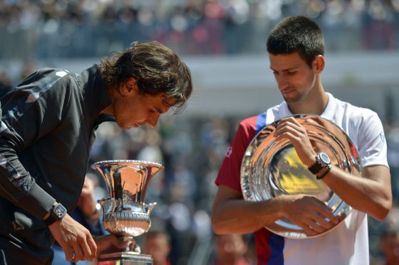 Rafael Nadal admires the Rome Masters trophy on Monday.