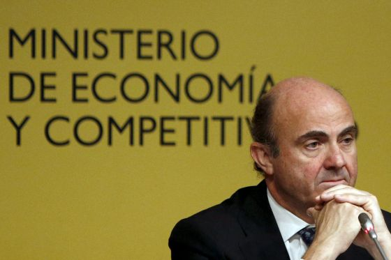 Guindos during a news conference in Madrid.