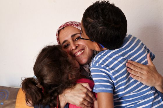 Houssnia el Khadiri with her children Fouad and Fadwa at home in Quijorna, Madrid.