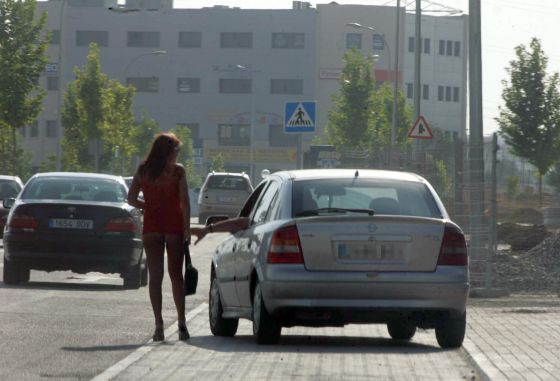A prostitute working in a street in southern Madrid.