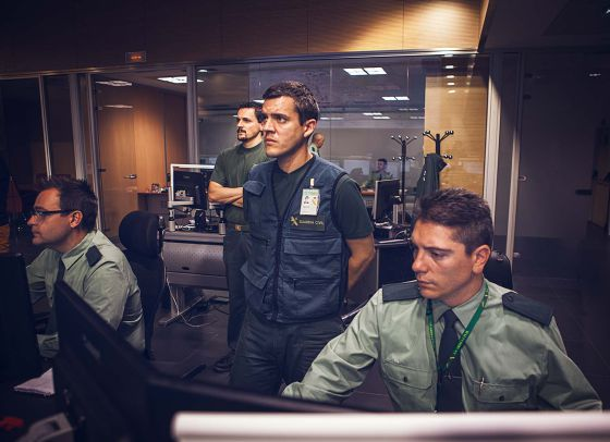 Three civil guards monitor real-time information in the Operations Room.