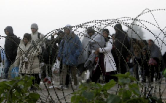A group of refugees crosses the border between Greece and Macedonia at the weekend.