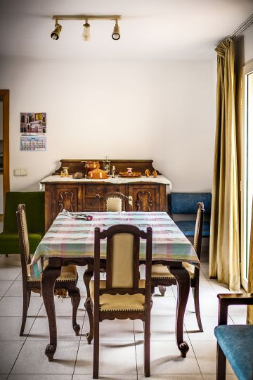 The dining room of the Church-run halfway house where Van der Dussen is now staying.