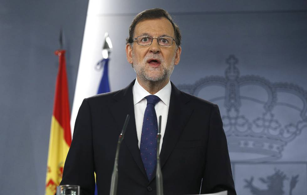 Acting PM Mariano Rajoy at a press conference on Friday.