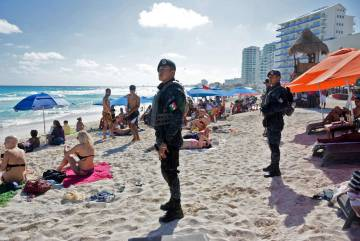 Image result for MEXICAN SOLDIERS ON BEACH WITH TOURISTS