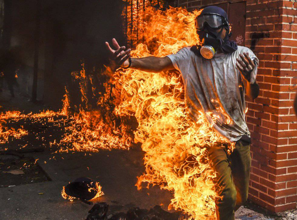 An opposition protester after blowing up the tank of a police motorbike on May 3 in Caracas.