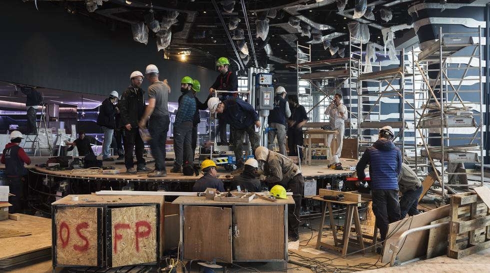 Construction crews prepare one of the theater stages on the new ship.