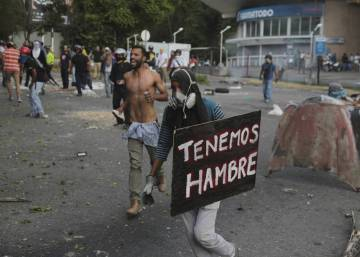 Two dead in Venezuela as protests spread to government stronghold