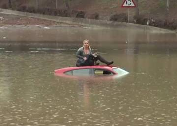 VIDEO: Dramatic rescue of woman from floating car in Spain