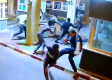 Video shows baton blows and kicks in bid to stop migrants entering Spain