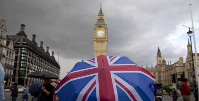 A pedestrian with a Union Flag umbrella passes by Big Ben in this file photo from June.