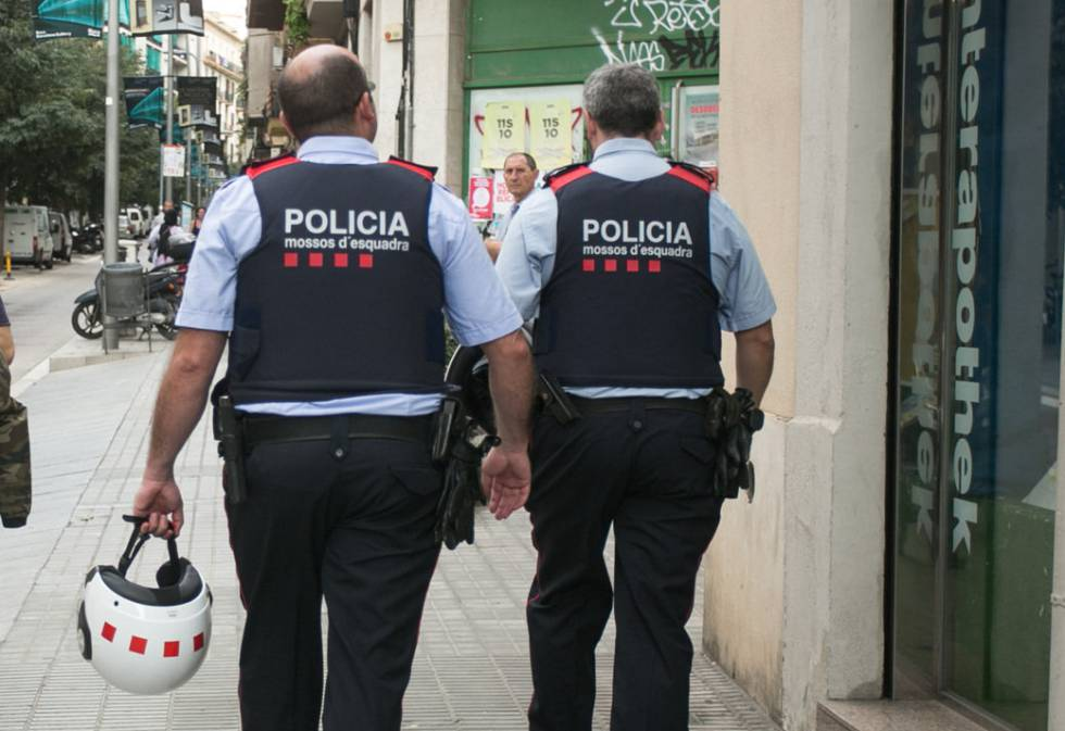 Officers with Catalonia's Mossos d' Esquadra police force.