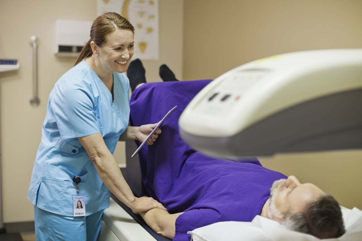 A bone-mineral density test is performed on a patient.