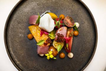 Garden tomatoes, Burela bonito and fig by Lucia Freitas.