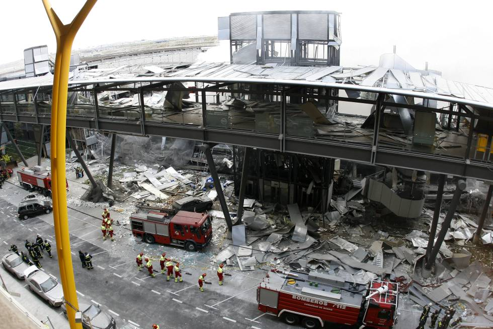 Fire crews on the scene of the 2006 bombing of a parking lot at Madrid's Barajas airport, which killed two.