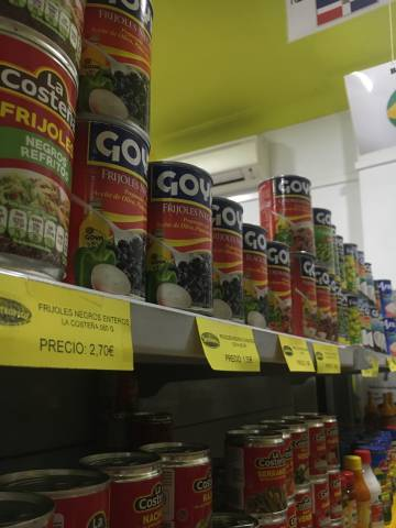 Shelves stacked with cans of 'Goya' beans in Intertropico, the Latin American grocery store just around the corner from Plaza de España.