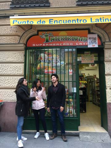 "Erasmus students from Mexico standing in front of the ""Punto de Encuentro Latino,"" or, Meeting point for Latinos in Madrid."