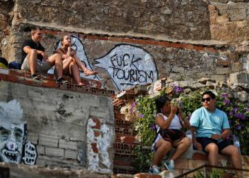 How can Spain ensure the survival of its world-beating tourism industry?
