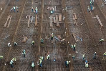 Fotos tiradas durante a construção do novo megaporto em Tuas, na costa ocidental de Singapura.