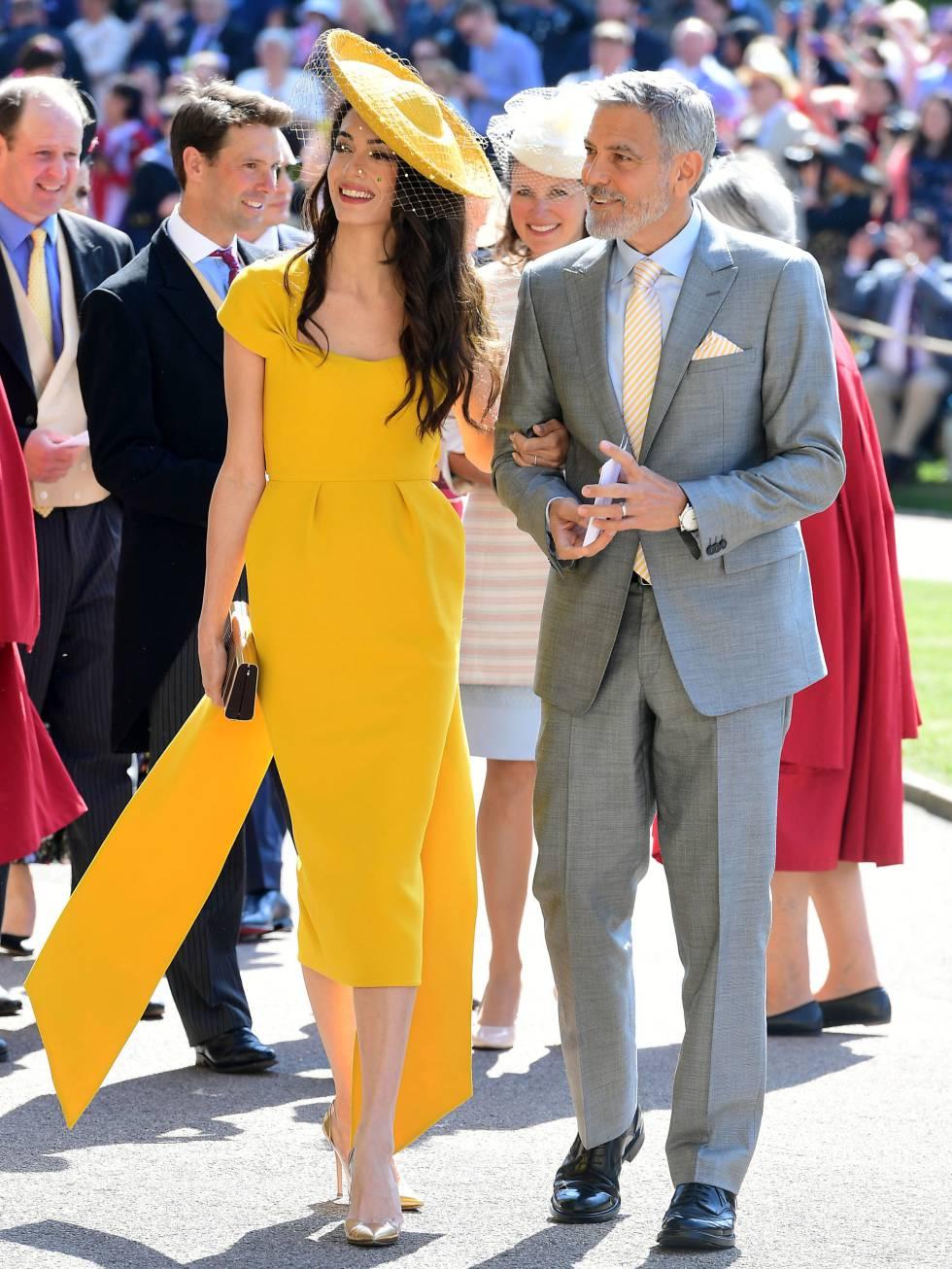 La abogada defensora de los derechos humanos Amal Clooney y su marido, el actor George Clooney, a la llegada de la boda de Meghan y Enrique.