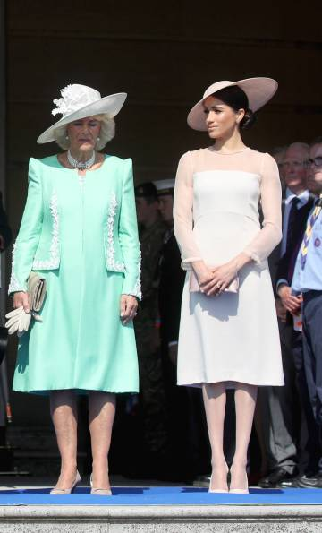 Camilla, duquesa de Cornualles y Meghan Markle.