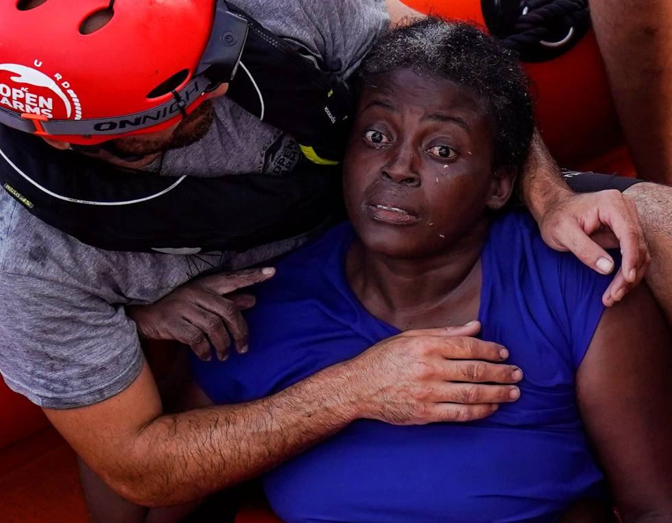 A crew member of NGO Proactiva Open Arms embraces the rescued woman.