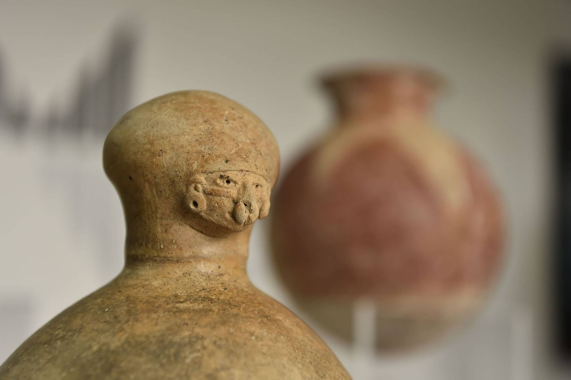 Archaeological pieces recovered by Ecuador are displayed at the National Museum in Quito on July 25, 2018. The National Institute of Cultural Heritage (INPC) recovered 13 pre-Hispanic archaeological pieces which were to be auctioned in Germany. The statues and vessels had been acquired by a private collector and taken illegally to Germany. AFP PHOTO Rodrigo BUENDIA