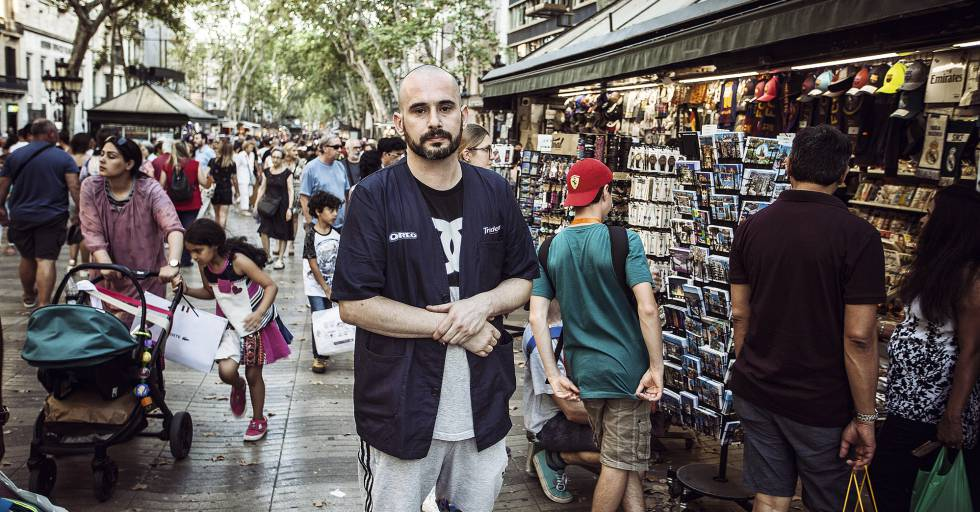 "Pablo Abecasis, 37, by his kiosk on La Rambla. On August 17, he was gravely injured by Younes. He remembers everything: ""The van was coming straight for me. It threw me into the air. I hit the windscreen with my head. I thought I would die."""
