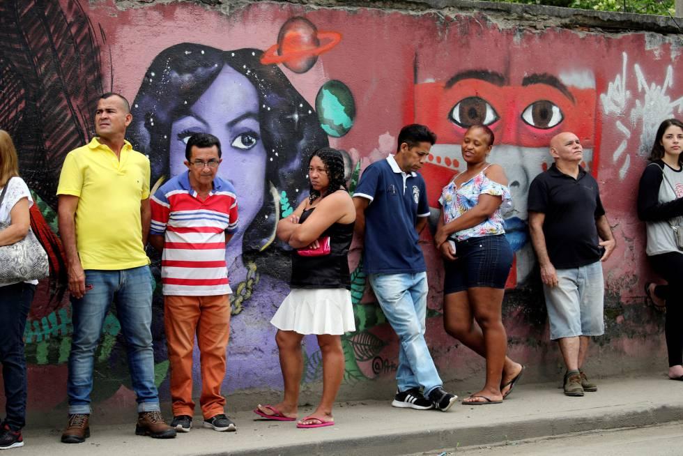Brasileños haciendo cola para votar en Río de Janeiro en las elecciones del pasado 28 de octubre.