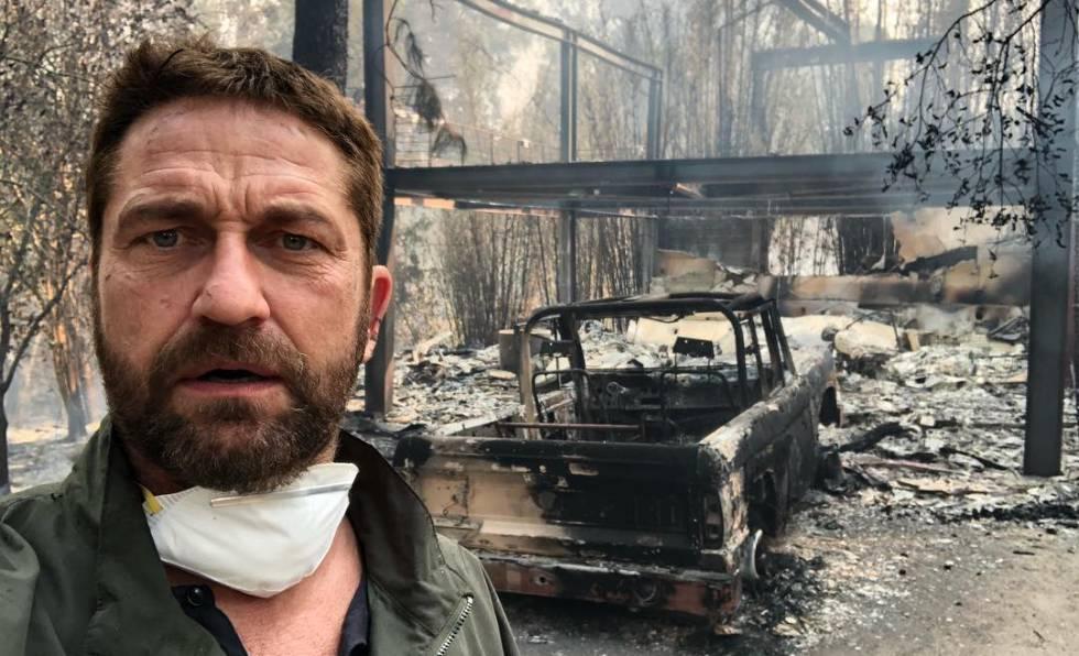 El actor y productor, Gerard Butler, junto a su casa destruida en Malibú.